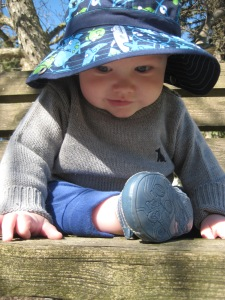 Happy baby playing outside.