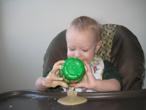 """I just love when Mom gives me a cup with no lid on it! This smoothie looks so good on my highchair tray!"""